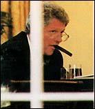 Bill Clinton with Cigar (photo credit: Cigar Aficionado)