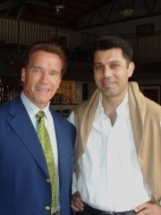Ahmad Mesdaq of The Gran Havana Cigar Lounge with Governator Schwarzenegger